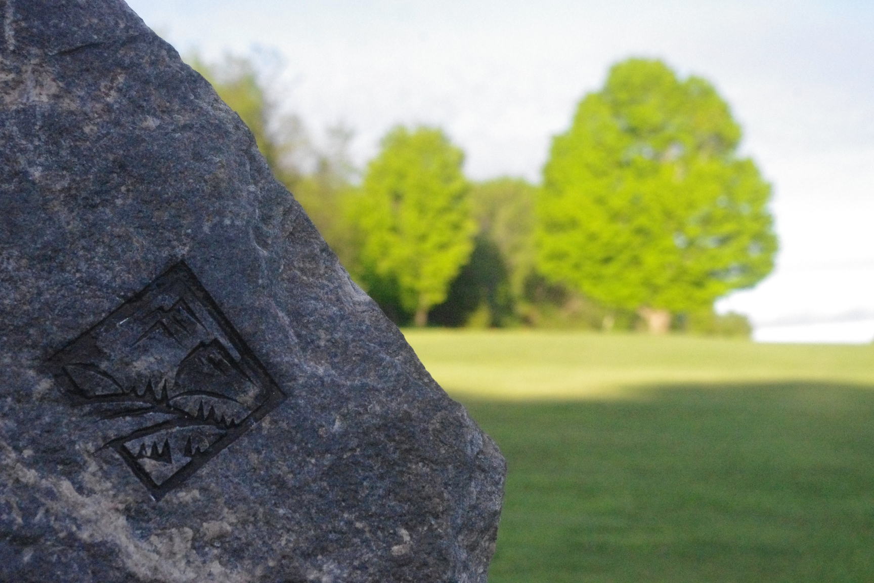 The Ridge logo on a rock