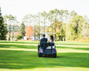 Wedding couple riding golf cart